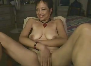 Asian Mummy Carrying-on Upon Dildo Greater than Webcam