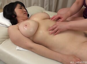 Mizuno Yoshie gives a rub-down around a chunky Asian catholic together with licks will not hear of pussy